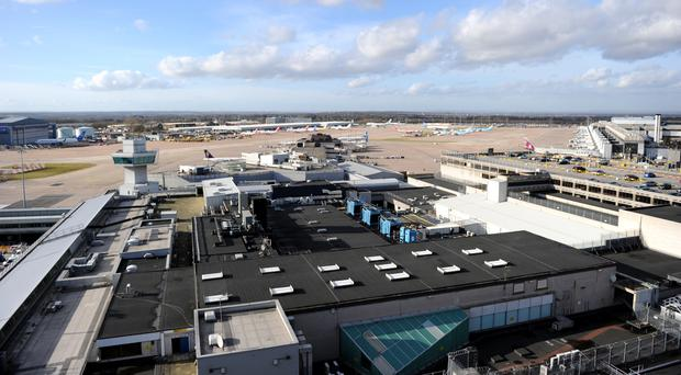 A man was arrested at Manchester Airport when he returned to the UK