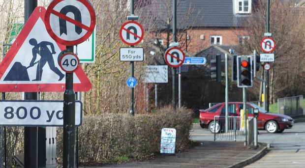 Road signs on a stretch of the A419 in Stonehouse, Gloucestershire