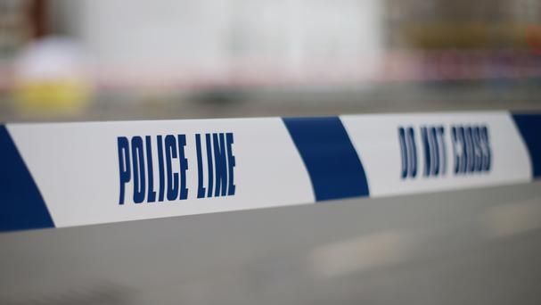 A suspect is wanted in connection with the murder of a 38-year-old man, who was found stabbed at an internet cafe in Smethwick