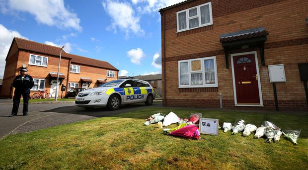 The scene outside a house in Spalding, Lincolnshire, where a woman and her daughter were found dead