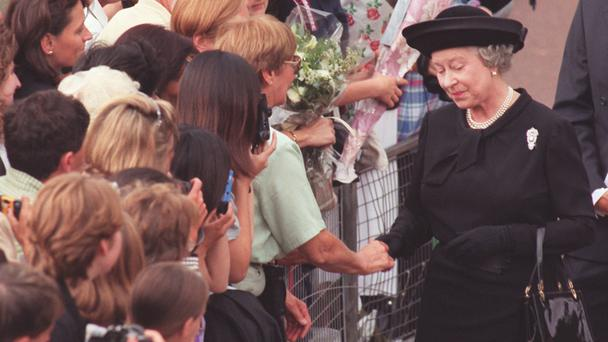 The Queen talks to mourners outside Buckingham Palace a day before the funeral of Diana, Princess of Wales