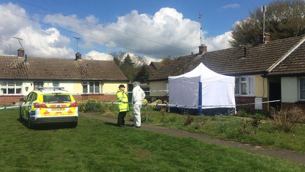 Police at a house in Chelmsford after the body of a woman and a critically injured man were found at the property.