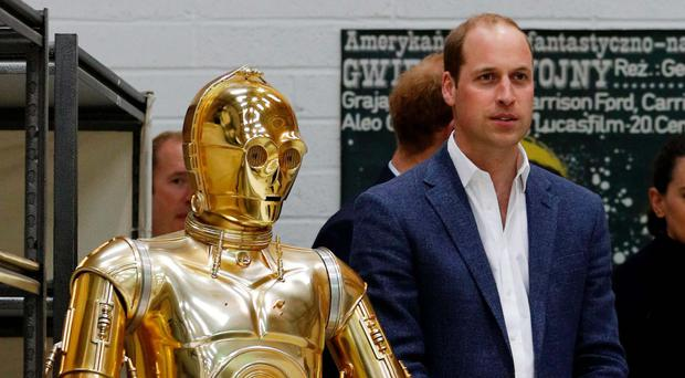 Prince William with C3P0 from Star Wars as they visit Pinewood Studios in Iver Heath, west of London, and meet the creative teams working behind the scenes