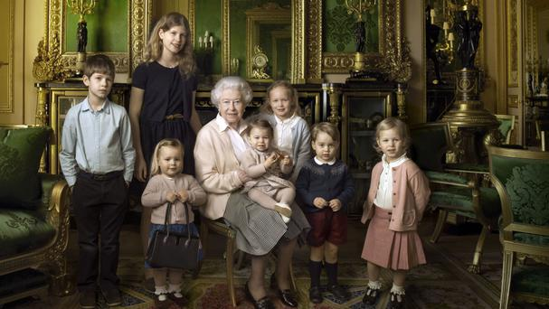 The Queen with her five great-grandchildren and her two youngest grandchildren in the Green Drawing Room, part of Windsor Castle's semi-State apartments. The children are: James, Viscount Severn (left), 8, and Lady Louise (second left), 12, the children of The Earl and Countess of Wessex; Mia Tindall (holding The Queen's handbag), the two year-old-daughter of Zara and Mike Tindall; Savannah (third right), 5, and Isla Phillips (right), 3, daughters of The Queen's eldest grandson Peter Phillips and his wife Autumn; Prince George (second right), 2, and in the Queen's arms the youngest great-grandchild, Princess Charlotte (11 months), children of The Duke and Duchess of Cambridge.
