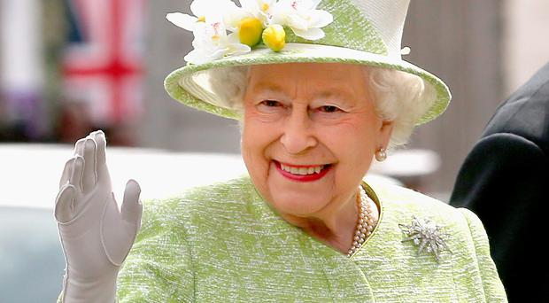 The Queen smiles during her 90th birthday walkabout in Windsor