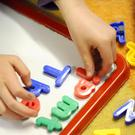 "Parties fighting the Assembly election have been warned childcare here ""lags woefully"" behind the rest of the UK"