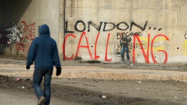 Charities are calling for Government action over more than 150 children with family in the UK who are stuck at a camp in Calais