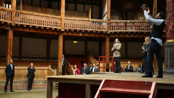 US president Barack Obama watches a performance during a visit to the Globe Theatre in London to mark the 400th anniversary of the death of William Shakespeare