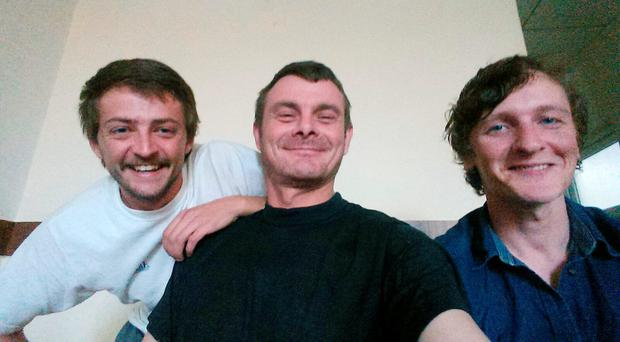 From left, Jac Holmes, Joe Akerman and Joshua Molloy take a selfie in Erbil, in the Kurdistan Region of Iraq, yesterday, following their release from jail