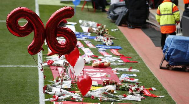 Flowers and balloons at the side of the pitch during the Hillsborough 27th anniversary memorial service at Anfield, Liverpool