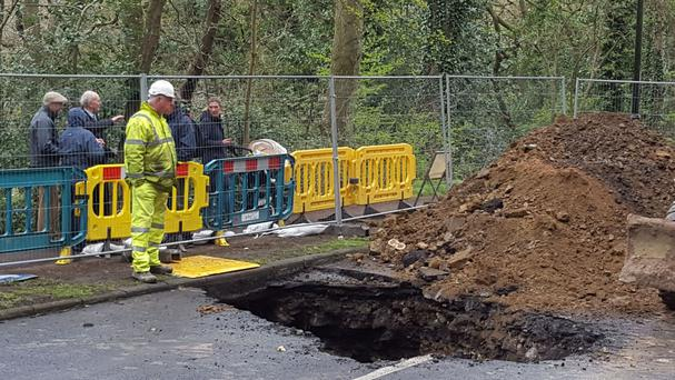Work is carried out on a sinkhole more than 20ft deep which appeared on Hutcliffe Wood Road in Sheffield