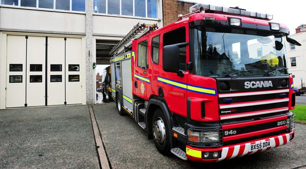 Labour are opposing plans to merge the fire service with police forces