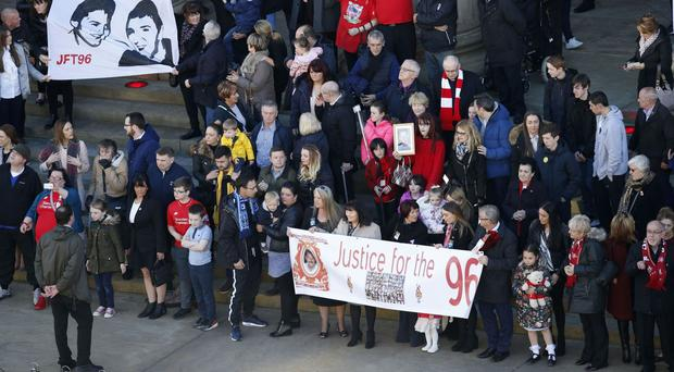 Family members of the Hillsborough victims attend a commemorative event at St George's Hall in Liverpool
