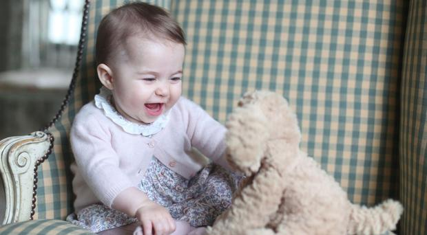 Princess Charlotte with a favourite toy at Anmer Hall in Sandringham in November 2015 (HRH The Duchess of Cambridge 2015/Kensington Palace/PA)