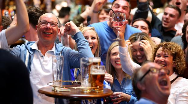 Foxes fans watch the game between Manchester United and Leicester City at a bar in Leicester
