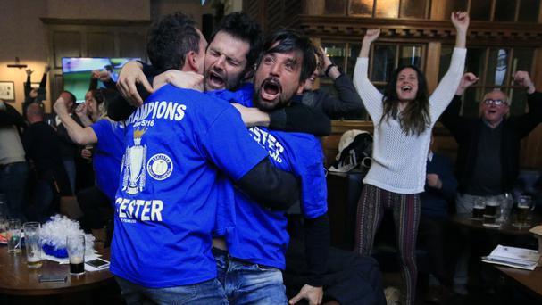 Leicester City fans celebrate in Hogarths pub
