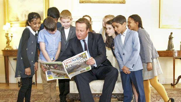 David Cameron with a group of 10-year-olds who interviewed him at Downing Street (First News/PA)