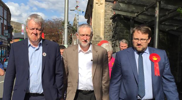 Welsh First Minister Carwyn Jones, left, and Labour leader Jeremy Corbyn, centre, campaign in Maesteg, south Wales