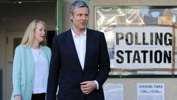 London mayoral candidate Zac Goldsmith leaves with his wife Alice after casting his vote at Kitson Hall, Barnes