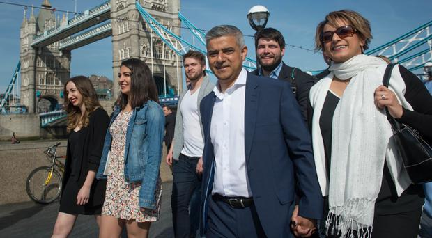 Labour mayoral candidate Sadiq Khan arrives at City Hall in London with his wife Saadiya and campaign team as counting continues on votes for the Mayor of London and the London Assembly elections