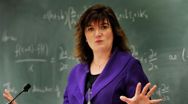 Nicky Morgan says the Government is dropping plans to force all schools in England to become academies