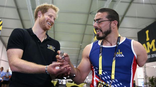 Prince Harry chats to Team USA Athlete Michael Kacer ahead of the Invictus Games 2016 at ESPN Wide World of Sports in Orlando, Florida (Invictus Games 2016/PA)
