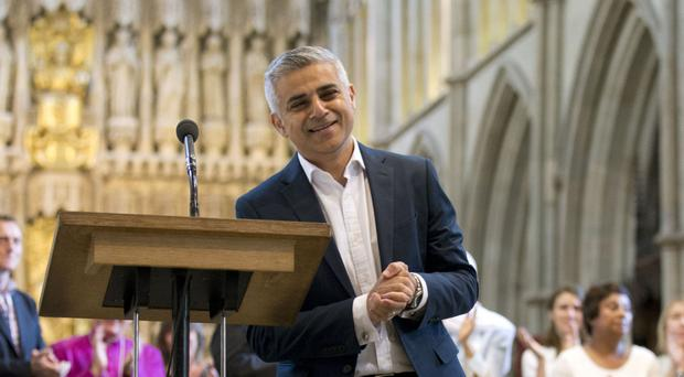 Sadiq Khan receives applause during the signing ceremony
