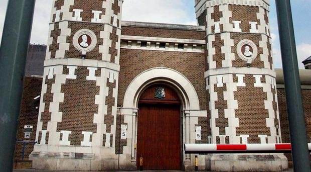 Two prison officers were taken to hospital after they were attacked at Wormwood Scrubs