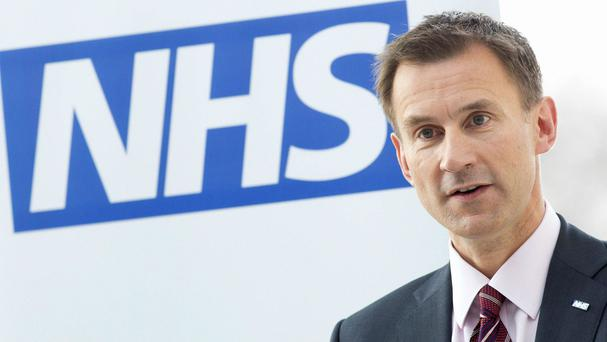 Health Secretary Jeremy Hunt said he would 'pause' the introduction of the new contract for junior doctors to allow further talks
