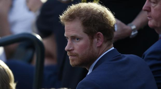 Prince Harry watches the opening ceremony of the Invictus Games in Orlando, Florida