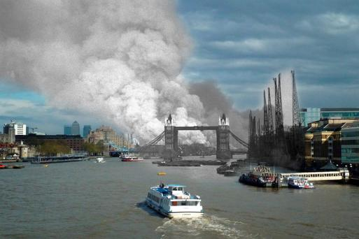A view east down the Thames towards smoke rising from fires in Surrey docks, following the first German air raid of the London Blitz, September 7, 1940