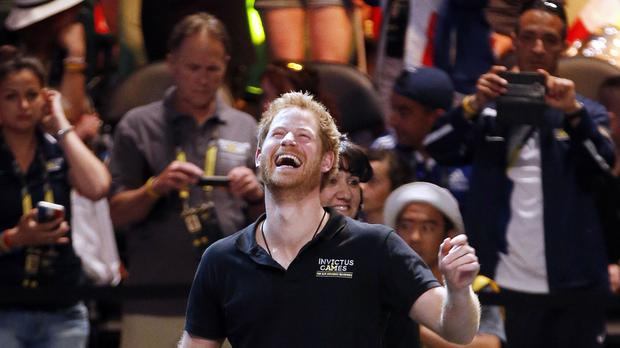 Prince Harry laughs at a joke as he presents a gold medal to UK rower Furgus Hurst at the Invictus Games 2016 at ESPN Wide World of Sports in Orlando, Florida