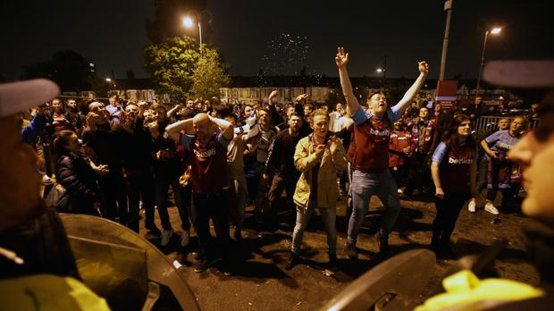 West Ham United fans and police outside Upton Park on Tuesday