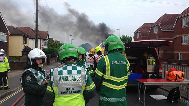 Emergency services close to the scene of a major blaze which broke out at a fireworks factory in Southampton (South Central Ambulance Service NHS Foundation Trust/PA)