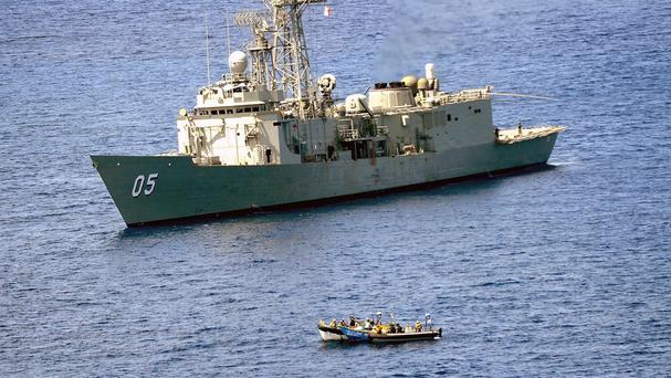 HMAS Melbourne closing in on a suspected pirate vessel in the Arabian Sea, off the coast of Somalia