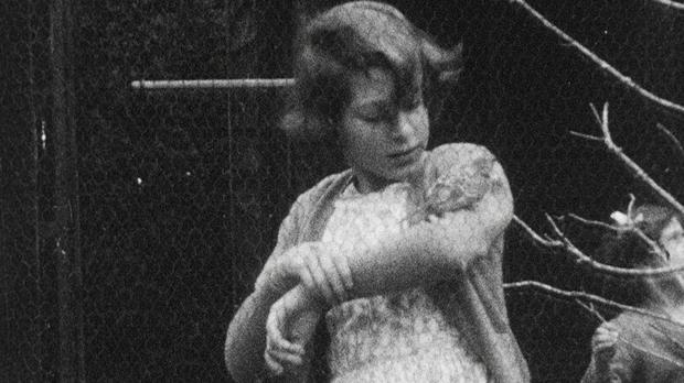 A still image taken from rare archive footage that will feature in The Queen's 90th Birthday Celebration which airs Sunday at 8.35pm on ITV. The picture shows Princess Elizabeth with a bird on her arm (HM The Queen/PA)