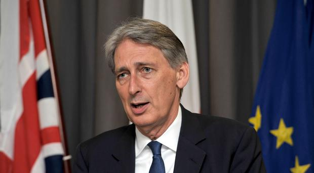 Foreign Secretary Philip Hammond has attended a summit in Nigeria