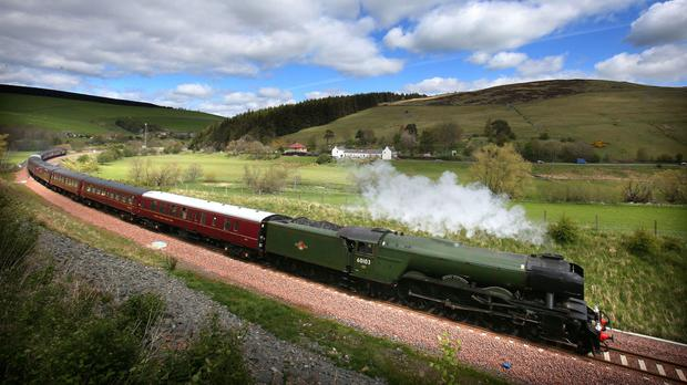 Flying Scotsman makes its way along the new Borders rail route near Heriot