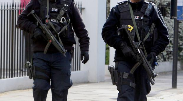 Police officers are not volunteering to carry guns because they fear being