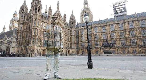 Veteran Darren Fuller painted by body artist Carolyn Roper to appear invisible to launch the Royal British Legion's campaign