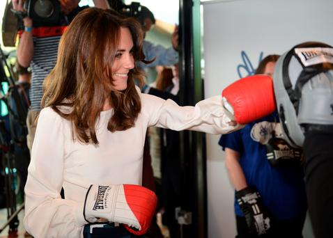 Catherine, Duchess of Cambridge tries out boxing at the launch of the Heads Together campaign in London to tackle mental health problems