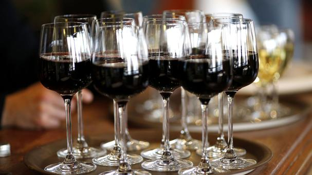 File photo dated 16/04/15 of a tray of glasses of red wine
