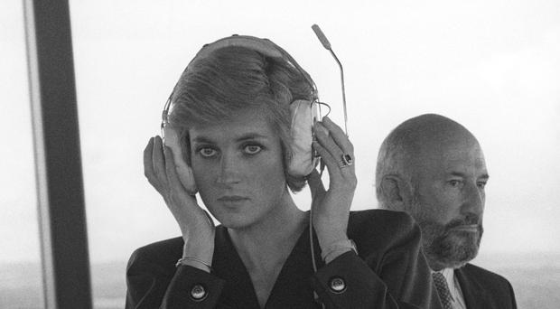 Diana, Princess of Wales listens to the dialogue of pilots as they come into land at Gatwick Airport during her visit to the Control Tower in 1988