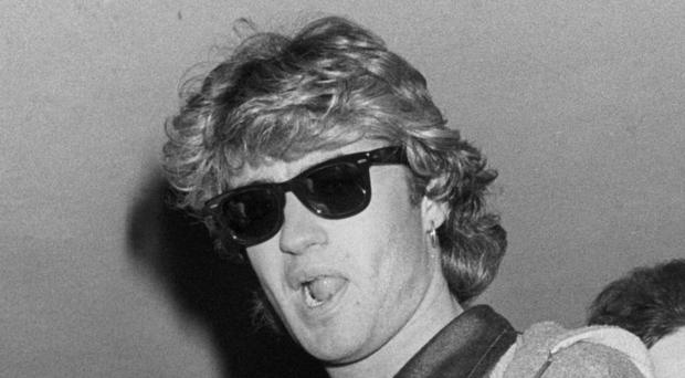 Wham! singer George Michael arriving back at Gatwick Airport following a two week tour of China in 1985