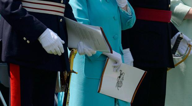 The Queen wipes her eye during a service at the National Memorial Arboretum in Alrewas, Staffordshire, in tribute to soldiers from the Duke of Lancaster's Regiment