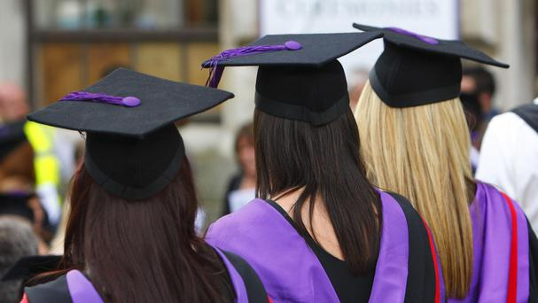 University graduates wearing mortarboards celebrate their success
