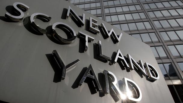 File photo dated 9/4/2009 of the sign outside New Scotland Yard. A specialist riot squad at the centre of a probe into allegations its officers wrongly claimed for overtime has been decommissioned to cut costs, police said.