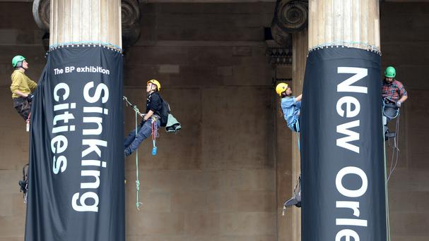 Greenpeace demonstrators climb the British Museum in London, in protest against BP's sponsorship of the museum's Sunken Cities exhibition