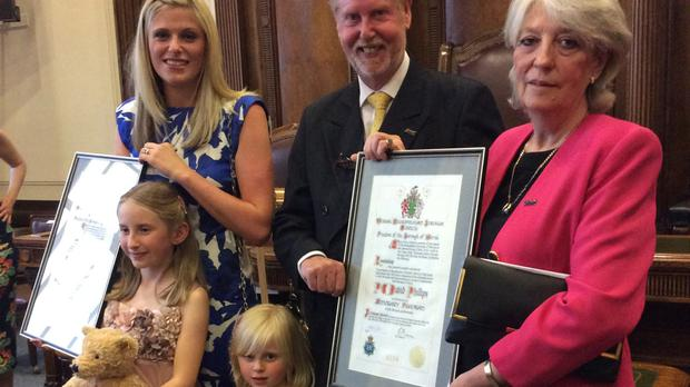 Pc Dave Phillips's widow Jen, their daughters Abigail (left) and Sophie, and his parents Robin and Carol attending the ceremony at Wallasey Town Hall (Wirral Council)