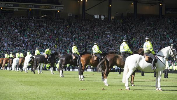 Police on horseback on the pitch after the Scottish Cup Final Hampden Park